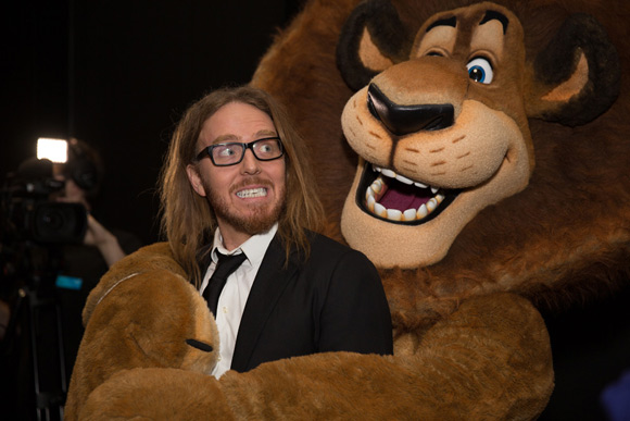 Tim enjoying an embrace from Alex the Lion Photographer Andrew Morley, Image courtesy ACMI
